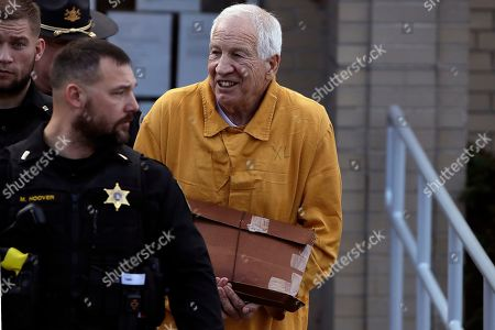 Former Penn State University assistant football coach Jerry Sandusky, center, leaves the Centre County Courthouse after attending a resentencing hearing on his 45-count child sexual abuse conviction