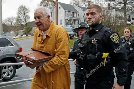 Former Penn State University assistant football coach Jerry Sandusky, left, arrives at the Centre County Courthouse for resentencing on his conviction of 45 counts child sexual abuse, in Bellefonte, Pa. Sandusky was convicted in 2012 and sentenced to 30 to 60 years