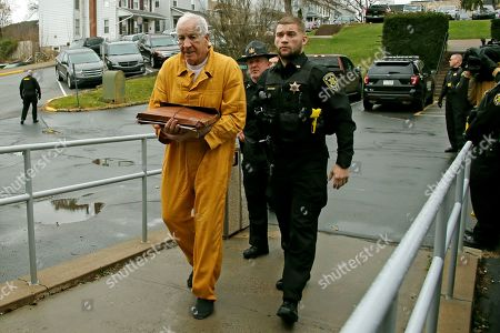 Former Penn State University assistant football coach Jerry Sandusky, left, arrives at the Centre County Courthouse for resentencing on his conviction of 45 counts of child sexual abuse, in Bellefonte, Pa. Sandusky was convicted in 2012 and sentenced to 30 to 60 years