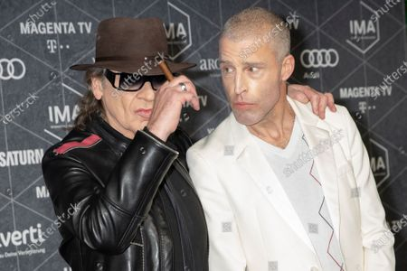 Udo Lindenberg (L) and German writer Benjamin von Stuckrad-Barre arrive at the red carpet of the International Music Award (IMA) 2019 in Berlin, Germany, 22 November 2019. The IMA recognizes the efforts of artists to share their work with a statement independently of the commercial success.