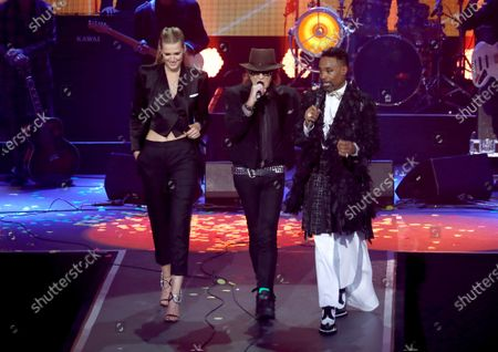 Toni Garrn, Udo Lindenberg and Billy Porter walk on stage during the International Music Award (IMA) 2019 in Berlin, Germany, 22 November 2019. The IMA recognizes the efforts of artists to share their work with a statement independently of the commercial success.