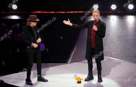 Sting (R) receives his IMA Hero Award from German singer Udo Lindenberg (L) during the International Music Award (IMA) 2019 in Berlin, Germany, 22 November 2019. The IMA recognizes the efforts of artists to share their work with a statement independently of the commercial success.