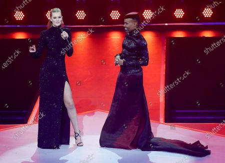 Toni Garrn (L) and US singer and actor Billy Porter stand on stage during the International Music Award (IMA) 2019 in Berlin, Germany, 22 November 2019. The IMA recognizes the efforts of artists to share their work with a statement independently of the commercial success.