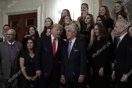 US President Donald Trump (3-L) with Education Secretary Betsy DeVos (hidden) greets athletes from the Texas Christian University Women's Rifle Team as part of NCAA Collegiate National Champions Day at the White House in Washington, DC, USA, 22 November 2019.