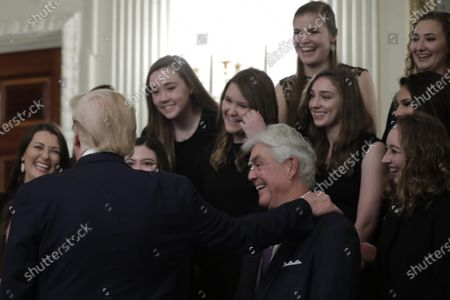 US President Donald Trump (L) with Education Secretary Betsy DeVos (hidden) greets athletes from the Texas Christian University Women's Rifle Team as part of NCAA Collegiate National Champions Day at the White House in Washington, DC, USA, 22 November 2019.