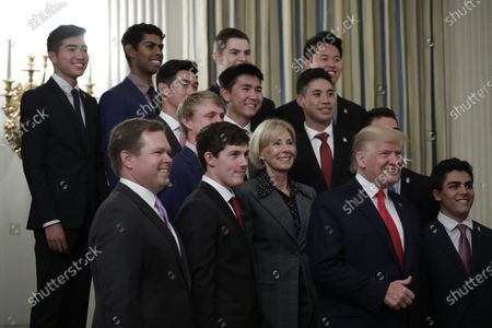 US President Donald Trump along with Education Secretary Betsy DeVos greets athletes from the Stanford University Men's Golf as part of NCAA Collegiate National Champions Day at the White House in Washington, DC, USA, 22 November 2019.