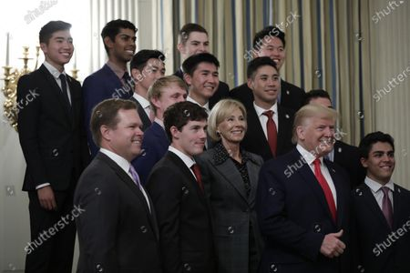United States President Donald Trump and US Secretary of Education Betsy DeVos pose with athletes from the Stanford University Men's Golf as part of NCAA Collegiate National Champions Day