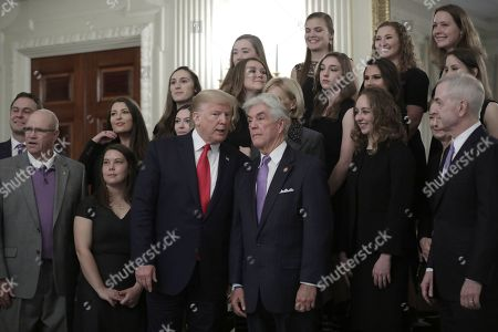 United States President Donald Trump with US Secretary of Education Betsy DeVos greets athletes from the Texas Christian University Women's Rifle Team as part of NCAA Collegiate National Champions Day