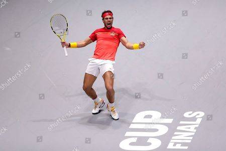 Spain's Rafael Nadal celebrates with his teammate Marcel Granollers after winning their Davis Cup quarterfinal match against Argentina's Maximo Gonzalez and Leonardo Mayer during the Davis Cup doubles tennis match in Madrid, Spain