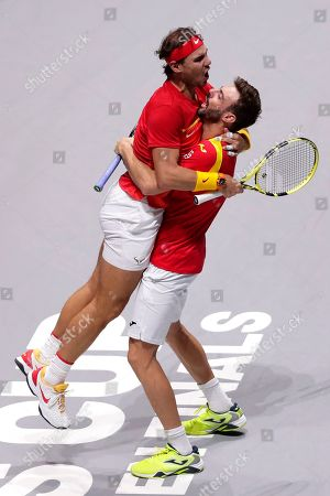 Spain's Rafael Nadal, left, and Marcel Granollers celebrate after winning their Davis Cup quarterfinal match against Argentina's Maximo Gonzalez and Leonardo Mayer during the Davis Cup doubles tennis match in Madrid, Spain