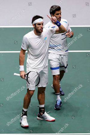 Argentina's Maximo Gonzalez, right, and Leonardo Mayer during their match against Spain's Rafael Nadal and Marcel Granollers during their Davis Cup doubles tennis match in Madrid, Spain