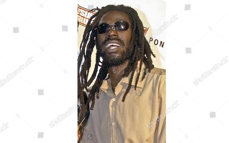 Jamaican reggae star Buju Banton poses at the Source Hip-Hop Music Awards in Miami. Jay-Z's Roc Nation company has added reggae star Buju Banton to its jam-packed roster. On Roc Nation announced the partnership with the reggae and dancehall king, whose comeback concert held earlier this year in his native Jamaica was one of the country's largest shows. More than 30,000 people attended the concert