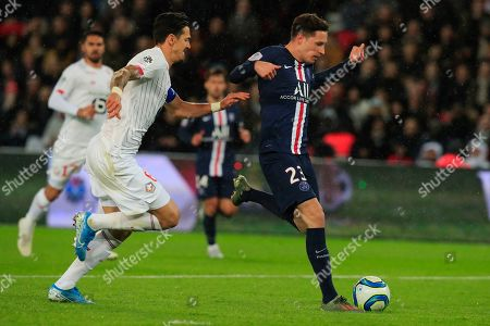 PSG's Julian Draxler, right, vies for the ball with Lille's Jose Fonte during French League One soccer match between Paris Saint-Germain and Lille at the Parc des Princes stadium in Paris