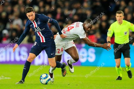 PSG's Julian Draxler, left, tussles for the ball with Lille's Boubakary Soumare during French League One soccer match between Paris Saint-Germain and Lille at the Parc des Princes stadium in Paris