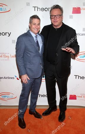 Stock Image of Adam Selkowitz and Tom Arnold