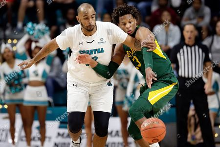 Coastal Carolina center Levi Cook, left, and Baylor forward Freddie Gillespie (33) chase the ball during the second half of an NCAA college basketball game at the Myrtle Beach Invitational in Conway, S.C