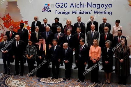 Stock Photo of Participants of the G20 Foreign Ministers meeting pose for a family photo during the G20 foreign ministers meeting, in Nagoya, Japan. Front from left are Germany's Foreign Minister Heiko Maas, Turkey's Foreign Minister Mevlut Cavusoglu, Indonesia's Foreign Minister Retno Marsudi, Saudi's Foreign Minister Prince Faisal bin Farhan, Japan's Foreign Minister Toshimitsu Motegi, Argentina's Foreign Secretary Jorge Faurie, China's Foreign Minister Wang Yi, European Union Foreign Policy chief Federica Mogherini, South Korea's Foreign Minister Kang Kyung-wha and Australia's Foreign Minister Marise Payne. Middle from left are U.S. Deputy Secretary of State John Sullivan, Senegal's Foreign Minister Amadou Ba, New Zealand's Deputy Prime Minister and Minister for Foreign Affairs Winston Peters, Spain's Foreign Minister Josep Borrell, India's Foreign Minister Subrahmanyam Jaishankar, Canada's Minister of Foreign Affairs Francois-Philippe Champagne, Singapore's Foreign Minister Vivian Balakrishnan, Dutch Foreign Minister Stef Blok, Chile's Foreign Minister Teodoro Ribera, United Kingdom's Minister for the Commonwealth, the UN and South Asia Tariq Ahmad. Back from left are Ambassador of Egypt to Japan Ayman Aly Kamel, Vietnam's Vice Foreign Minister Bui Thanh Son, South Africa's Deputy Minister of International Relations and Cooperation Candith Mashego-Dlamini, Italy's Deputy Foreign Minister Emanuela Claudia Del Re, Frence's Minister of State attached to the Minister for Europe and Foreign Affairs Jean-Baptiste Lemoyne, Mexico's Deputy Secretary of Foreign Affairs Julian Ventura Valero, Brazil's Secretary for Commercial and Economic Foreign Policy Norberto Moretti, and Thailand's Advisor to Foreign Minister Pornpimol Kanchanalak