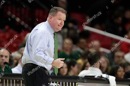 George Mason coach Dave Paulsen talks to his team against during the first half of an NCAA college basketball game against Maryland, in College Park, Md. Maryland won 86-63