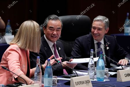 European Union Foreign Policy Chief Federica Mogherini (L), China's Foreign Minister Wang Yi (C) and Canada Foreign Minsiter Francois-Philippe Champagne (R) attend the first plenary session of the G20 Foreign Ministers' meeting in Nagoya, Japan, 23 November 2019. The foreign ministers meeting of the Group of 20 major economies will take place on 22 and 23 November.