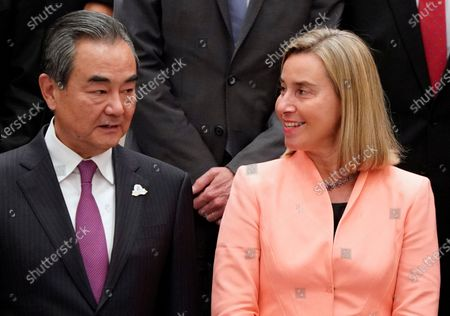 China's Foreign Minister Wang Yi (L) and European Union Foreign Policy Chief Federica Mogherini (R) speak during a family photo at the G20 Foreign Ministers' meeting in Nagoya, Japan, 23 November 2019. The foreign ministers meeting of the Group of 20 major economies will take place on 22 and 23 November.