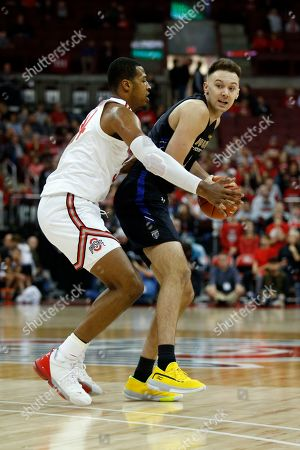 Stock Image of Purdue Fort Wayne forward Dylan Carl, right, drives against Ohio State forward Kaleb Wesson during an NCAA college basketball game in Columbus, Ohio, . Ohio State won 85-46