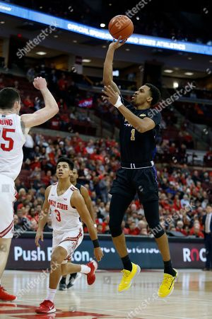 Purdue Fort Wayne guard Jarred Godfrey, right, goes up for a shot in front of Ohio State guard D.J. Carton, center, and forward Kyle Young during an NCAA college basketball game in Columbus, Ohio, . Ohio State won 85-46