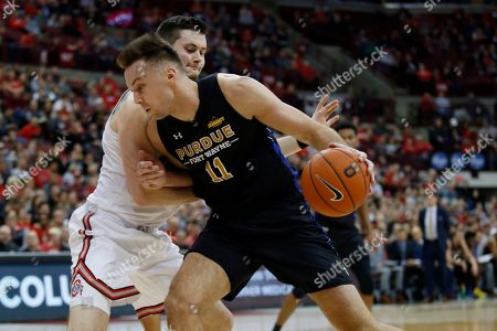 Purdue Fort Wayne forward Dylan Carl, left, drives in front of Ohio State forward Kyle Young during an NCAA college basketball game in Columbus, Ohio, . Ohio State won 85-46