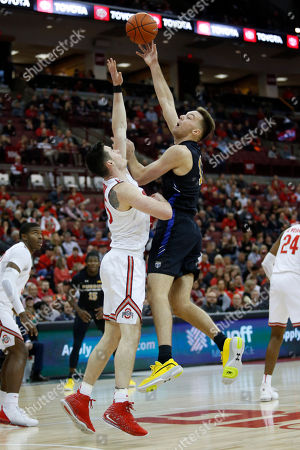 Purdue Fort Wayne forward Dylan Carl, right, goes up for a shot in front of Ohio State forward Kyle Young during an NCAA college basketball game in Columbus, Ohio, . Ohio State won 85-46