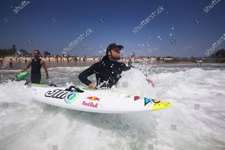 Stock Image of Three time World Surfing champion Mick Fanning joins in demonstrations at Currumbin, on the Gold Coast, Australia, 23 November 2019. Protests were held around Australia in opposition to plans for Norwegian oil company Equinor to drill in the waters of the Great Australian Bight.