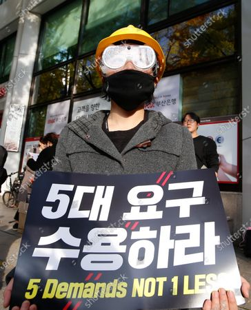 A South Korean student protester holds a placard during a demonstration for democracy for Hong Kong, outside the Chinese embassy in Seoul, South Korea, 23 November 2019. The protesters gathered to support Hong Kong protests, Hong Kong is in its sixth month of mass protests, which were originally triggered by a now withdrawn extradition bill, and have since turned into a wider pro-democracy movement.