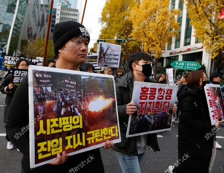 South Korean student protesters hold placards during a demonstration for democracy for Hong Kong, outside the Chinese embassy in Seoul, South Korea, 23 November 2019. The protesters gathered to support Hong Kong protests, Hong Kong is in its sixth month of mass protests, which were originally triggered by a now withdrawn extradition bill, and have since turned into a wider pro-democracy movement.