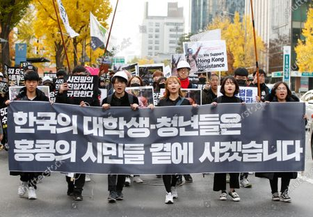 South Korean student protesters shout slogans and hold placards during a demonstration for democracy for Hong Kong, outside the Chinese embassy in Seoul, South Korea, 23 November 2019. The protesters gathered to support Hong Kong protests, Hong Kong is in its sixth month of mass protests, which were originally triggered by a now withdrawn extradition bill, and have since turned into a wider pro-democracy movement.