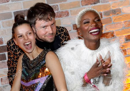 Niklas Kortlaender (C) and Elise Eissmann (L) of the duo Tochter and Nikeata Thompson (R) attend the after party of the International Music Award (IMA) 2019 in Berlin, Germany, 22 November 2019 (issued 23 November 2019). The IMA recognizes the efforts of artists to share their work with a statement independently of the commercial success.