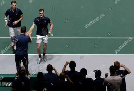 Great Britain's Neal Skupski, left, his partner Jamie Murray, right, and team captain Leon Smith celebrate a point against Spain's Rafael Nadal and Feliciano Lopez during their Davis Cup semifinal doubles match, in Madrid, Spain