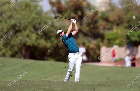Justin Rose of England plays a shot during the third round of the DP World Tour Championship European Tour Golf tournament 2019 at Jumeirah Golf Estates in Dubai, United Arab Emirates, 23 November 2019.