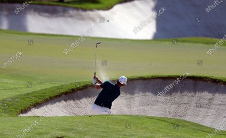 Justin Rose of England hits out of a bunker during the third round of the DP World Tour Championship European Tour Golf tournament 2019 at Jumeirah Golf Estates in Dubai, United Arab Emirates, 23 November 2019.
