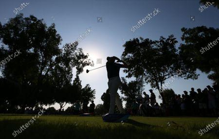 Justin Rose of England watches his tee shot during the third round of the DP World Tour Championship European Tour Golf tournament 2019 at Jumeirah Golf Estates in Dubai, United Arab Emirates, 23 November 2019.