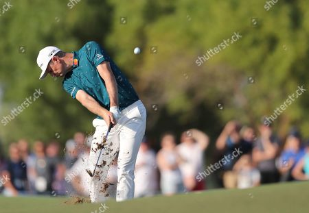 Justin Rose of England plays a shot on the 16th hole during the third round of the DP World Tour Championship golf tournament in Dubai, United Arab Emirates