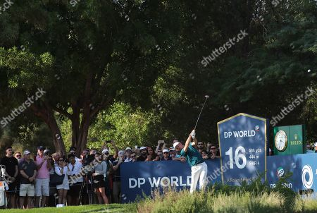 Justin Rose of England tees off on the 16th hole during the third round of the DP World Tour Championship golf tournament in Dubai, United Arab Emirates