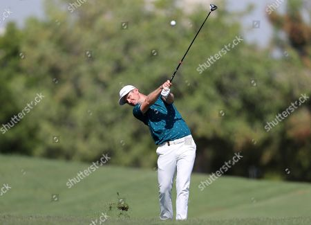 Justin Rose of England plays a shot on the 2nd hole during the third round of the DP World Tour Championship golf tournament in Dubai, United Arab Emirates