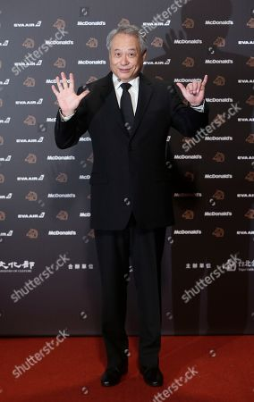 Taiwanese director Ang Lee poses on the red carpet at the 56th Golden Horse Awards in Taipei, Taiwan