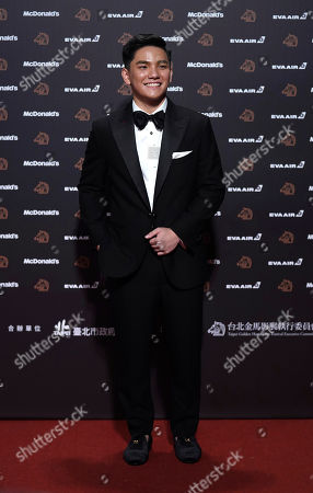 """Stock Photo of Singapore actor Koh Jia-ler arrives at the 56th Golden Horse Awards in Taipei, Taiwan, . Koh is nominated for Best Supporting Actor for the film """"Wet Season"""" at this year's Golden Horse Awards -one of the Chinese-language film industry's biggest annual events"""