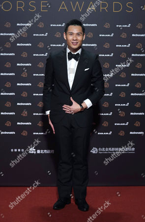 """Stock Photo of Singapore director Anthony Chen arrives at the 56th Golden Horse Awards in Taipei, Taiwan, . Chen is nominated for Best Director for the film """"Wet Season"""" at this year's Golden Horse Awards -one of the Chinese-language film industry's biggest annual events"""