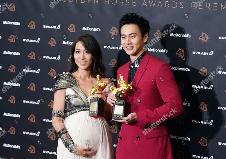 """Winnie Chang, Liu Kuan-ting. Taiwanese actress Winnie Chang, left, and Taiwanese actor Liu Kuan-ting hold their awards for Best Supporting Actress and Best Supporting Actor at the 56th Golden Horse Awards in Taipei, Taiwan, . Chang won for the film """"The Teacher"""" and Liu for the film """"A Sun"""" at this year's Golden Horse Awards -the Chinese-language film industry's biggest annual events"""