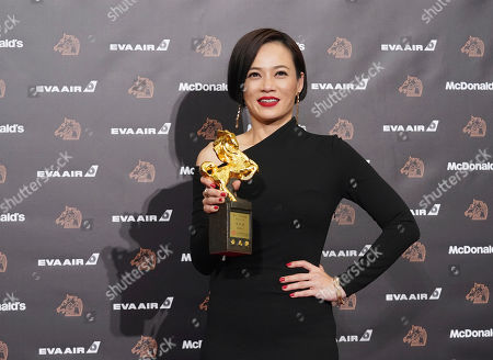 "Malaysian actress Yeo Yann-yann holds her award for Best Leading Actress at the 56th Golden Horse Awards in Taipei, Taiwan, . Yeo won for the film ""Wet Season"" at this year's Golden Horse Awards -the Chinese-language film industry's biggest annual events"