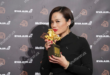 "Malaysian actress Yeo Yann-yann kisses her award for Best Leading Actress at the 56th Golden Horse Awards in Taipei, Taiwan, . Yeo won for the film ""Wet Season"" at this year's Golden Horse Awards -the Chinese-language film industry's biggest annual events"