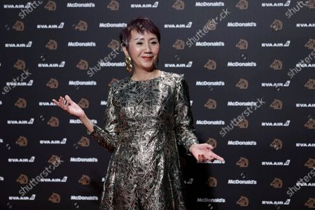 Stock Picture of Lu Yi-ching poses for photographs at the 56th Golden Horse Awards ceremony in Taipei, Taiwan, 23 November 2019. The film awards established in 1962 are presented to filmmakers working in Chinese-language cinema.