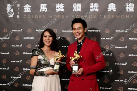 Stock Image of Taiwanese actors Winnie Chang (L) and Liu Kuan-ting pose for photographs after winning the Best Supporting Actress and Actor awards respectively at the 56th Golden Horse Awards ceremony in Taipei, Taiwan, 23 November 2019. The film awards established in 1962 are presented to filmmakers working in Chinese-language cinema.