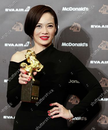 Malaysian actress Yeo Yann-Yann poses for photographs after winning the Best Leading Actress award at the 56th Golden Horse Awards ceremony in Taipei, Taiwan, 23 November 2019. The film awards established in 1962 are presented to filmmakers working in Chinese-language cinema.