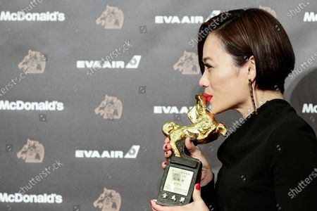 Stock Image of Malaysian actress Yeo Yann-Yann poses for photographs after winning the Best Leading Actress award at the 56th Golden Horse Awards ceremony in Taipei, Taiwan, 23 November 2019. The film awards established in 1962 are presented to filmmakers working in Chinese-language cinema.